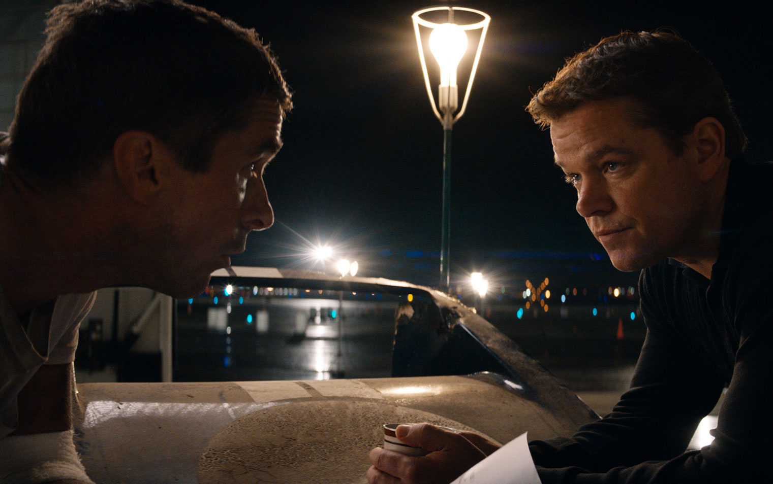 Movie still of actors Christian Bale and Matt Damon in Ford vs Ferrari from director James Mangold