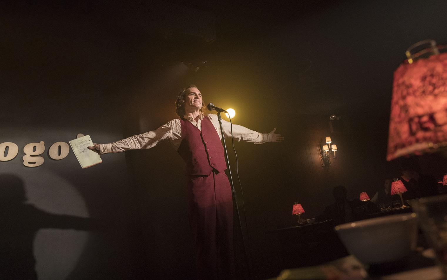 Film still from Joker of Arthur Fleck (Joaquin Phoenix) at comedy club