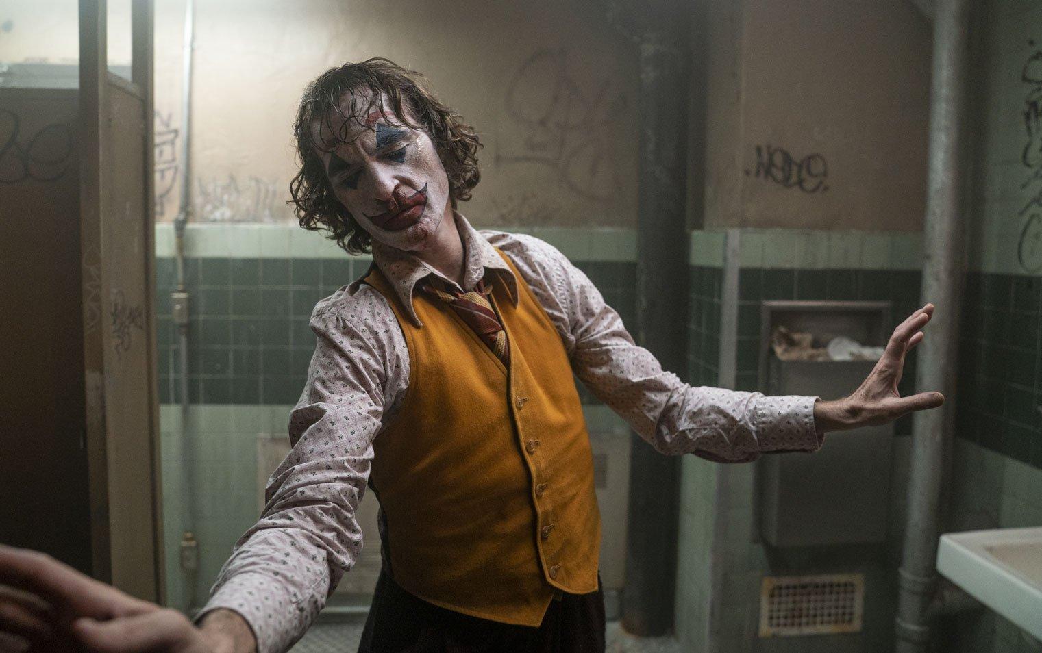 Film still from Joker of Arthur Fleck (Joaquin Phoenix) dancing in bathroom