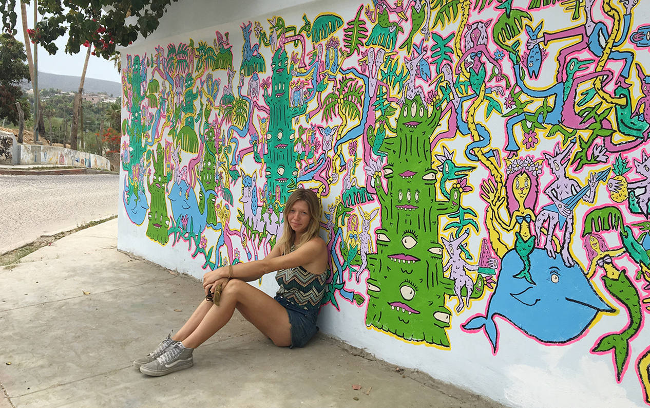 Bay area musician and artist Charlotte Hacker-Mullen in front of one of her many murals.